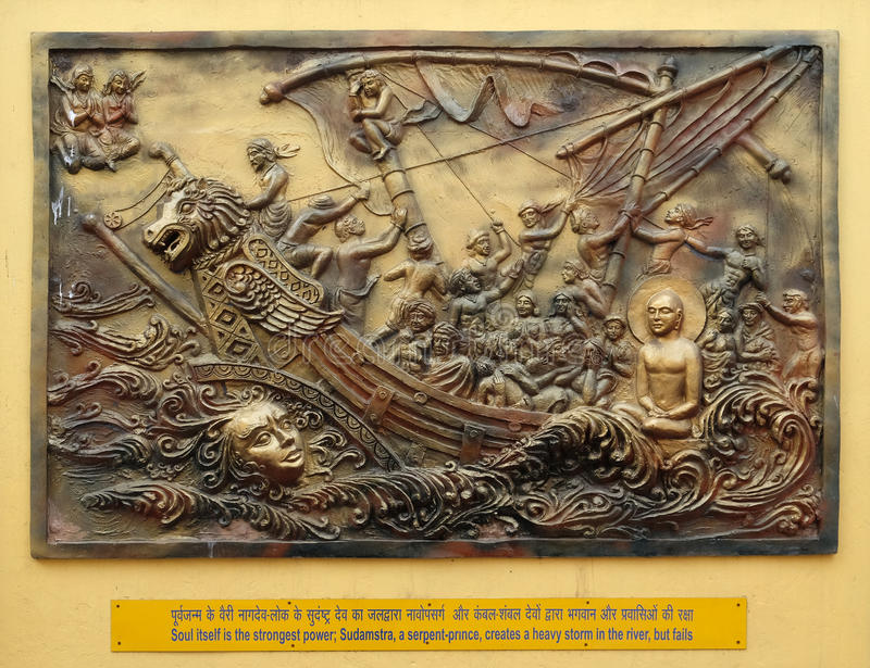 Soul itself is the strongest power; Sudamstra, a serpent-prince, creates a heavy storm in the river, but fails. Street bass relief on the wall of Jain Temple royalty free stock image