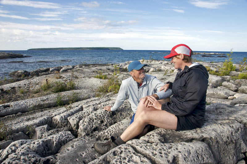 Soul Mates. Baby Boomers celebrate life in the outdoors surrounded by the rugged beauty of Georgian Bay, Ontario. This area - Fathom Five National Marine Park stock photo