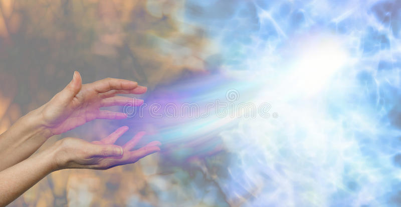 Soul midwife. Female hands on a darkness to light background and a soul energy formation moving out towards the light depicting soul release stock image