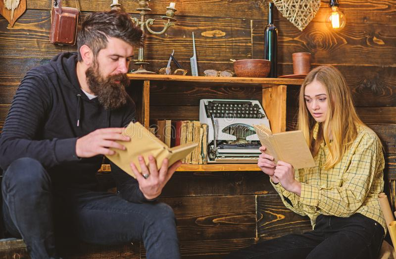 Soulful evening concept. Girl and man on calm faces reading book in warm atmosphere. Father instills love to books for. Soulful evening concept. Girl and men on stock photo