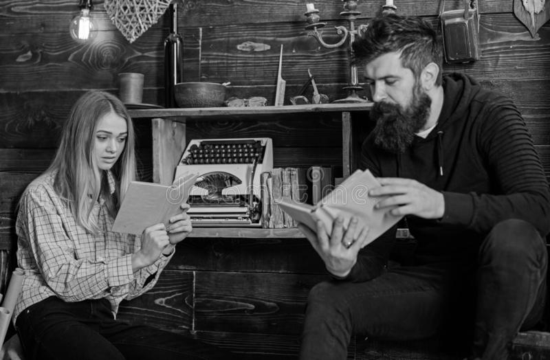 Soulful evening concept. Girl and man on calm faces reading book in warm atmosphere. Father instills love to books for. Soulful evening concept. Girl and men on stock photography