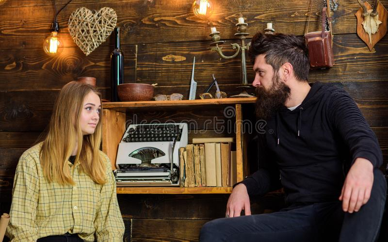 Soulful evening concept. Girl and man on calm faces talking, enjoy warm atmosphere while having rest. Friends spend. Soulful evening concept. Girl and men on royalty free stock photo