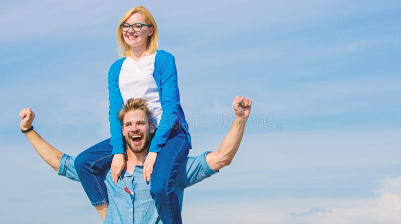 Soulmates enjoy freedom together. Couple in love enjoy freedom outdoor sunny day. Man carries girlfriend on shoulders. Sky background. Couple happy date having royalty free stock images