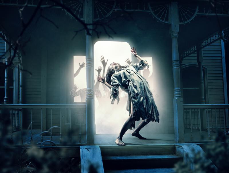 Souls of victims in abandoned house at the night. Photo in horror style, mystery and exorcism stock photo