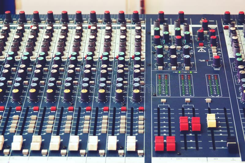 Sound and audio mixer control panel with buttons and sliders.  stock photo