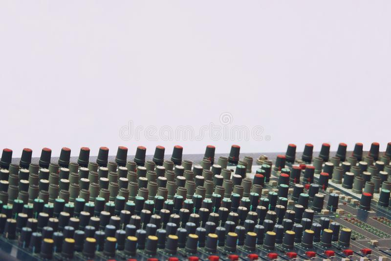 Sound and audio mixer control panel with buttons and sliders.  stock photos