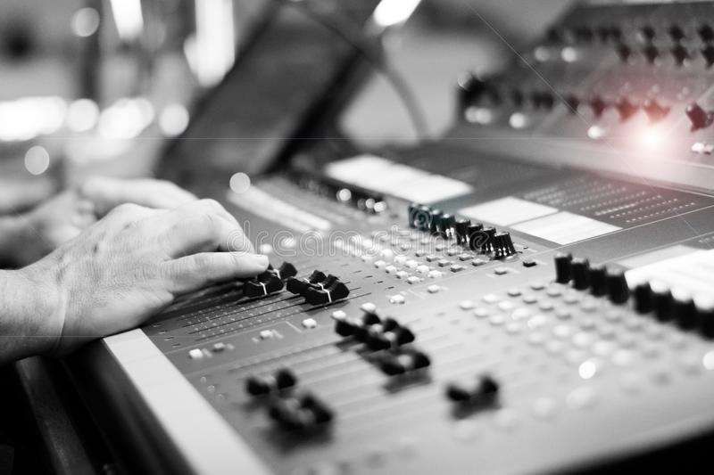 Sound board audio equipment with hands. Black and white sound board mixer music audio equipment with hands royalty free stock photos