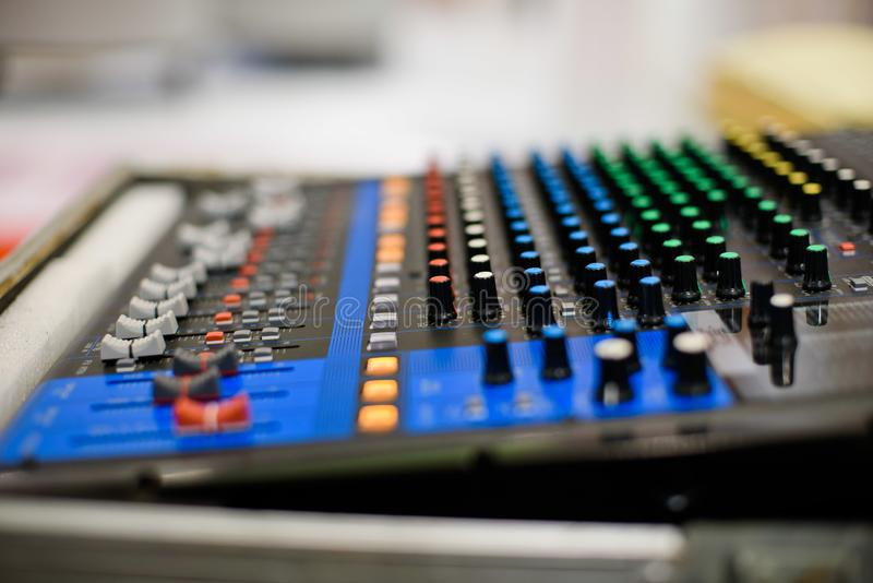 Sound check for concert, mixer control, music engineer, backstage royalty free stock image