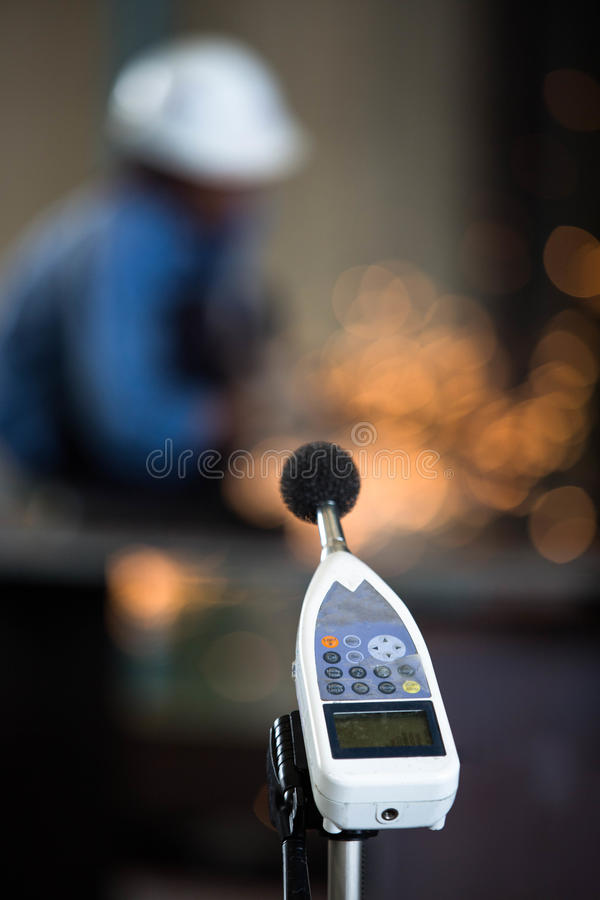 Sound detector for test level decibel in grinding process at work shop. Sound detector for test level decibel at work shop stock photography