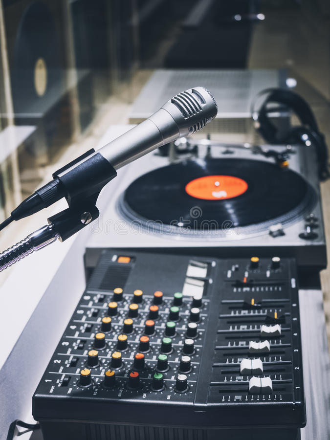 Sound Engineer Mixing Control Microphone Vinyl Record royalty free stock image