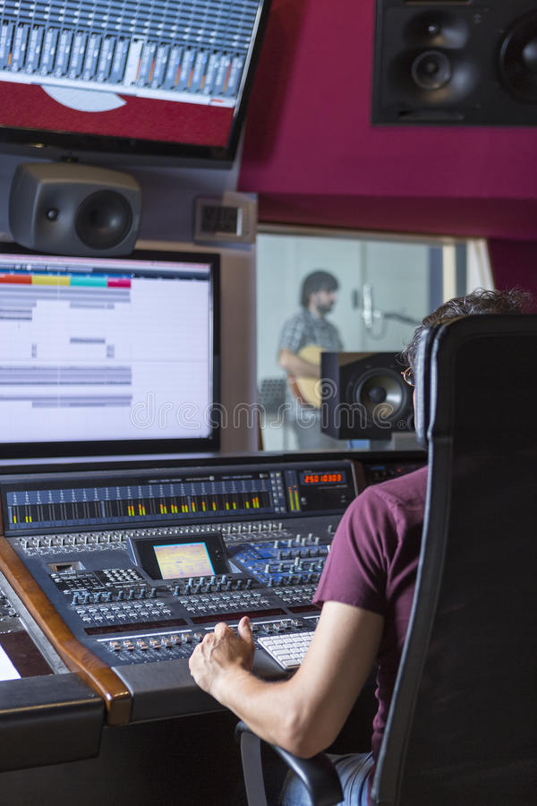 Sound engineer at recording studio stock photography