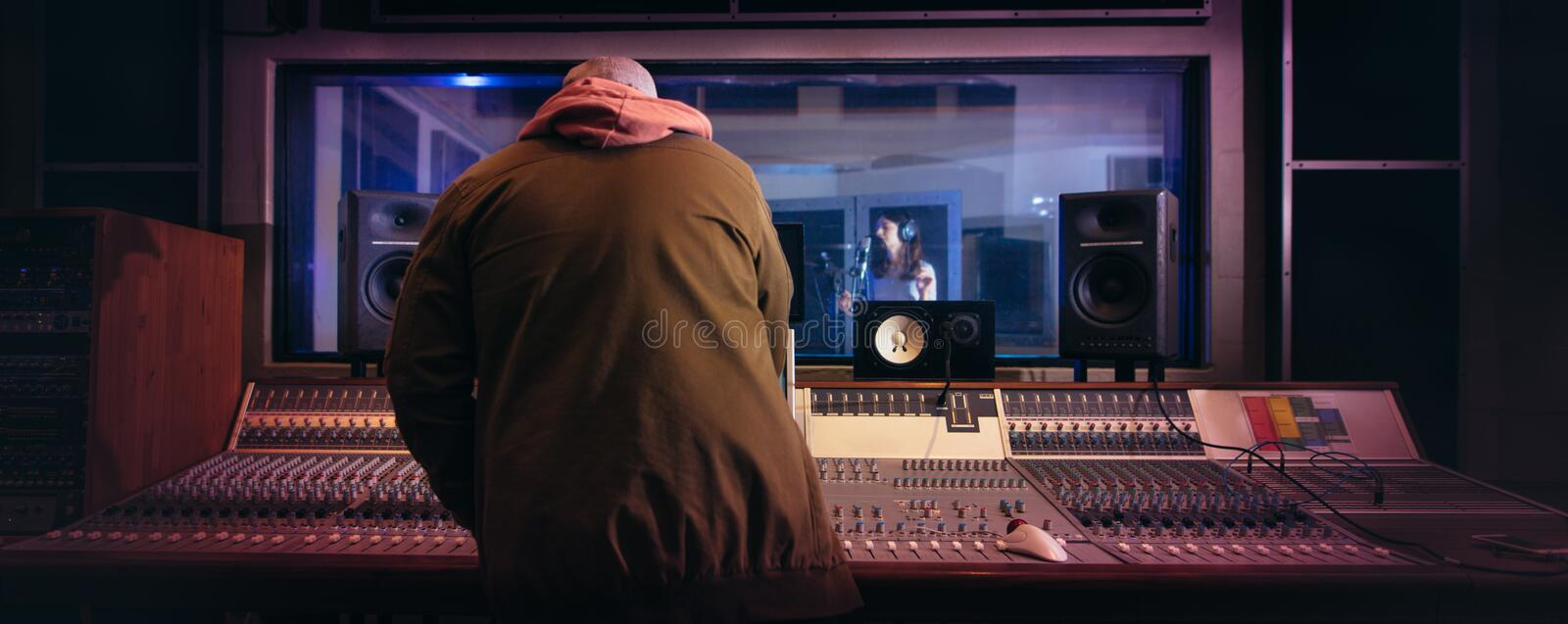 Musicians producing music in professional recording studio royalty free stock photography