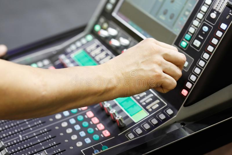 Sound engineer working with audio mixer stock image