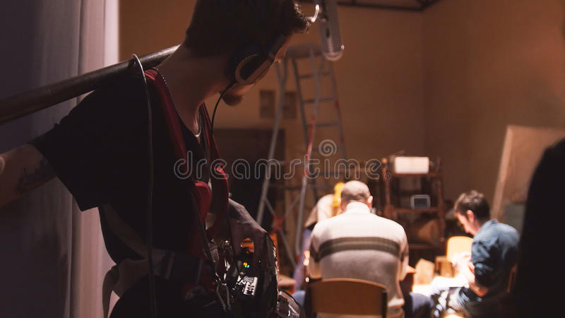 Sound engineer working on the independent cinema production - film set. Wide angle royalty free stock photos