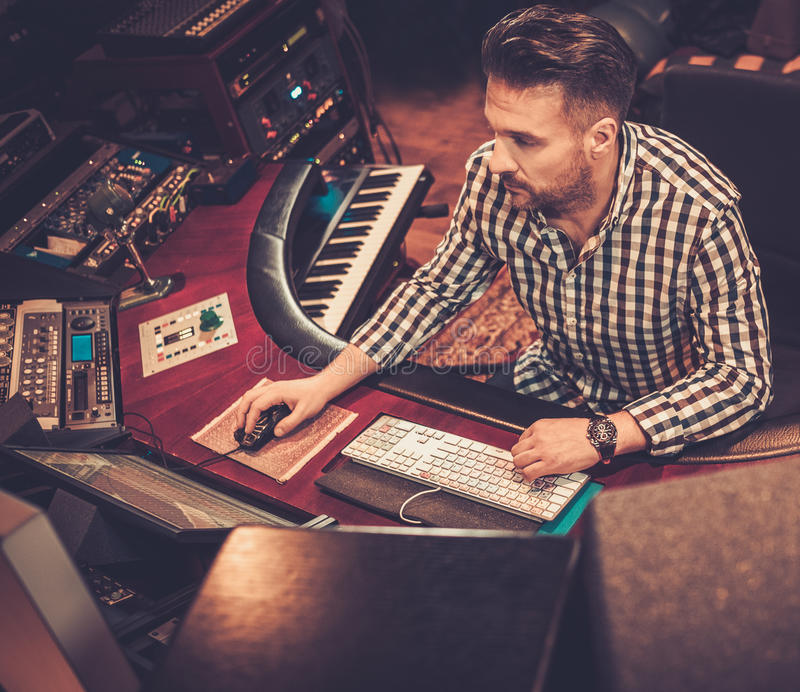 Sound engineer working at mixing panel stock images