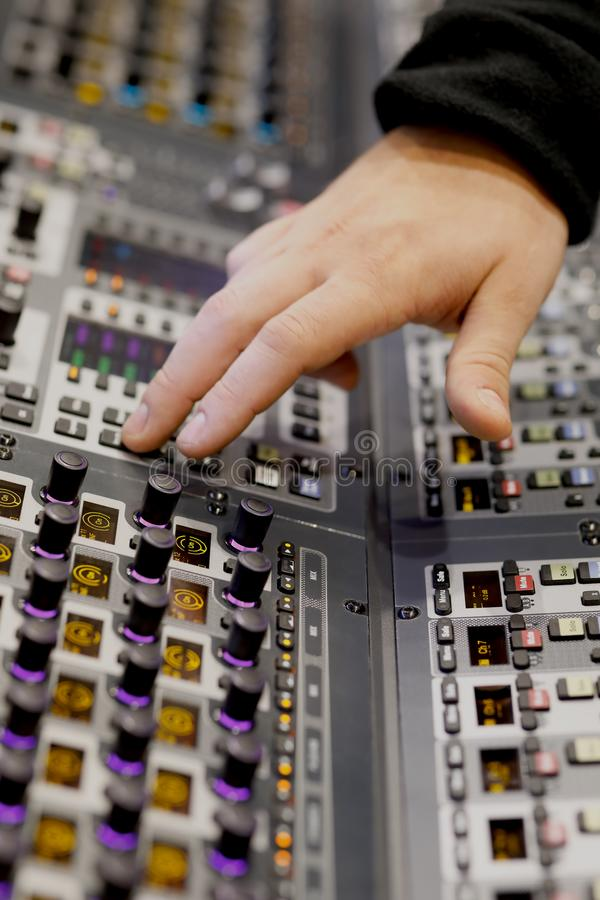 Sound engineer working on music mixer console stock image