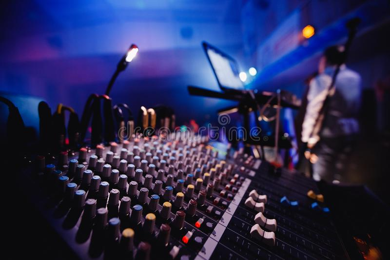 Sound equipment close-up, dancing in nightclub. background is man in white clothes with microphone royalty free stock image