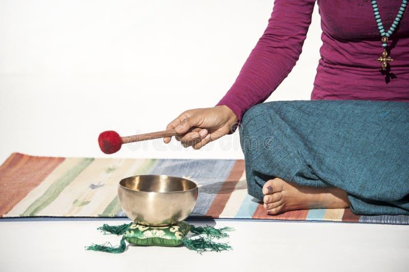 Sound Healer Yoga Woman White Background royalty free stock image