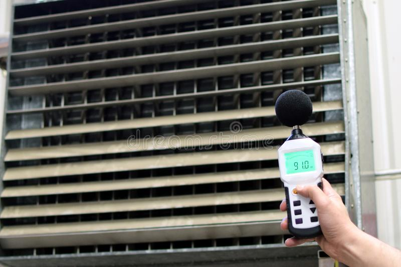 Sound level meter measuring the noise of industrial ventilation unit. Horizontal image royalty free stock photos