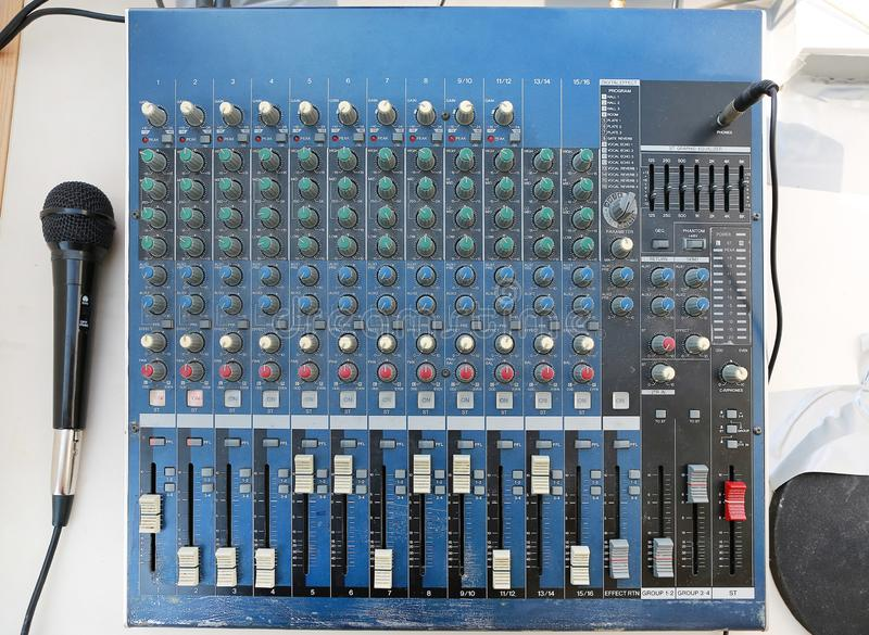 Sound levels on a professional audio mixer with microphone, Music control panel royalty free stock images