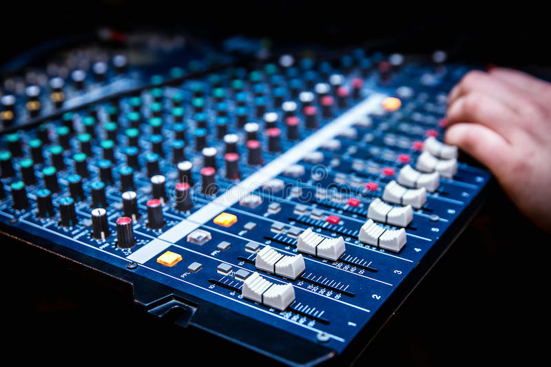 Sound manager is working on the audio mixer stock photos