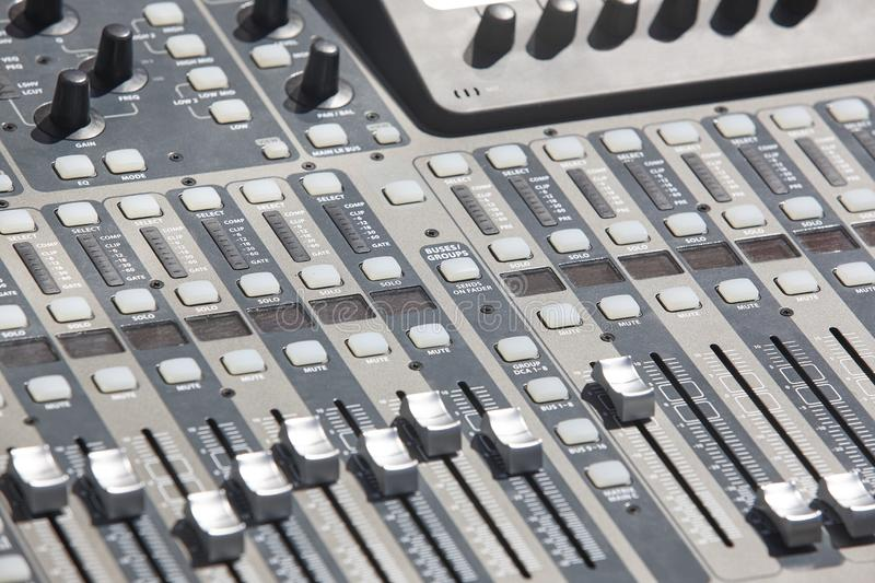Sound mixer console detail with sliders and levels. Audio royalty free stock photography