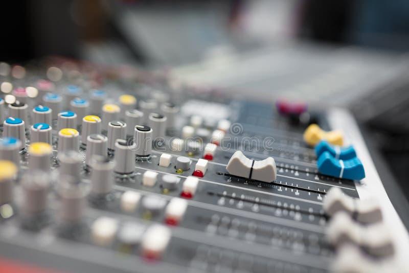 Sound mixer in radio broadcasting and music recording studio royalty free stock photo