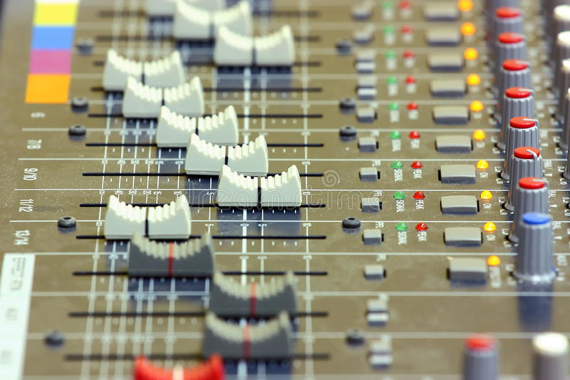 Sound mixing. Console (desk) in a recording studio close up shot royalty free stock photo