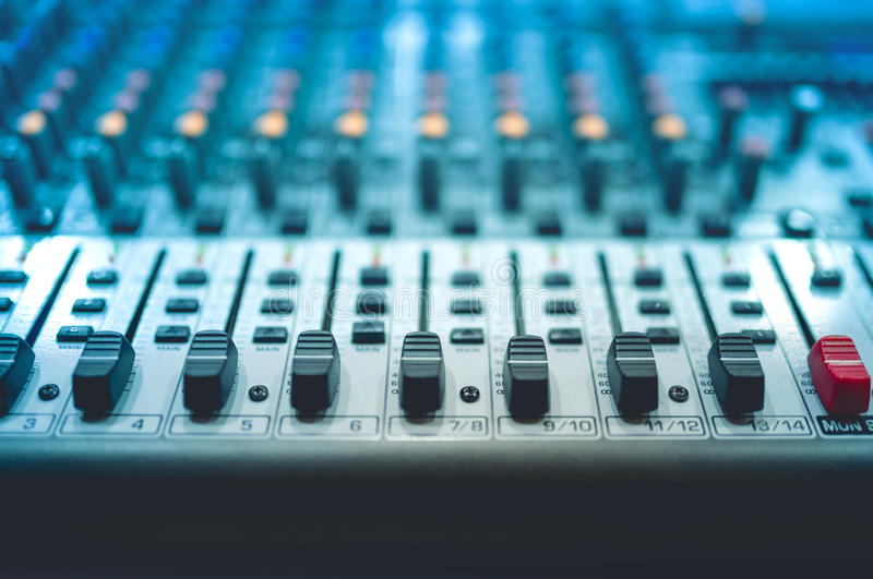Sound and music mixer adjustments on local device at party in a night club stock image