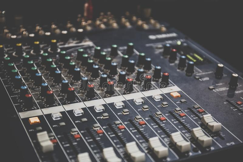 Sound operator console or sound mixer control panel of DJ for music mixing and recording on studio or party royalty free stock photos