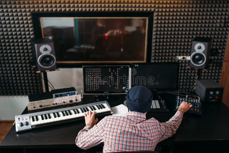 Sound producer work with audio equipment in studio royalty free stock photography