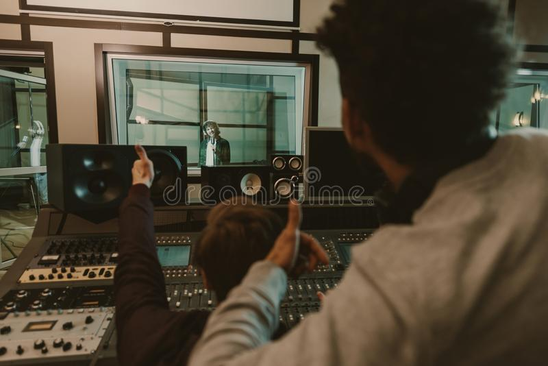 sound producers showing thumbs up to singer stock image