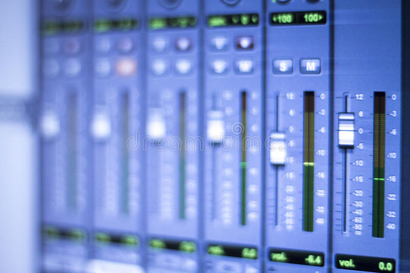 Sound recording audio studio. Professional sound recording audio studio digital equipment, amplifier, knobs and digital graphic equalizer controls on screen royalty free stock photography