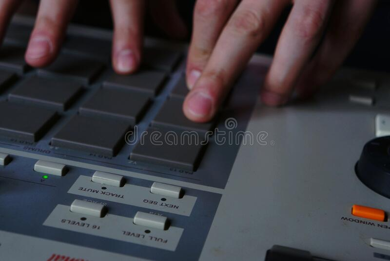 Hip hop music. Sound recording equipment.Hip hop music producer makes beat on push button production controller device.Disc jockey play beats on push pads.Media stock photography