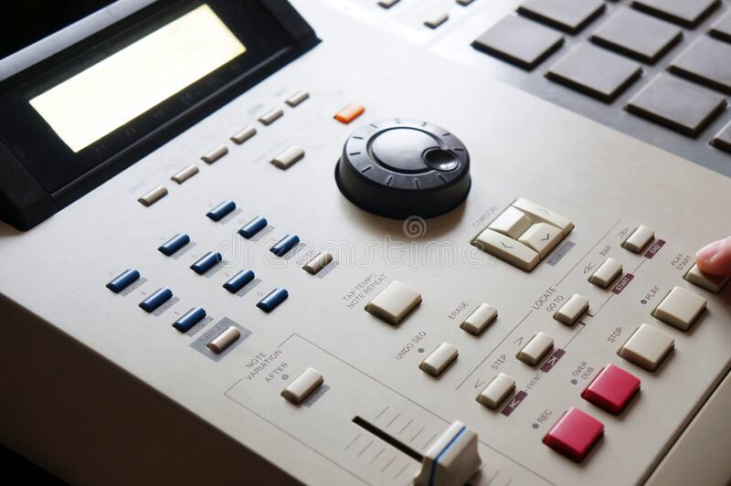 Hip hop music. Sound recording equipment.Hip hop music producer makes beat on push button production controller device.Disc jockey play beats on push pads.Media stock images