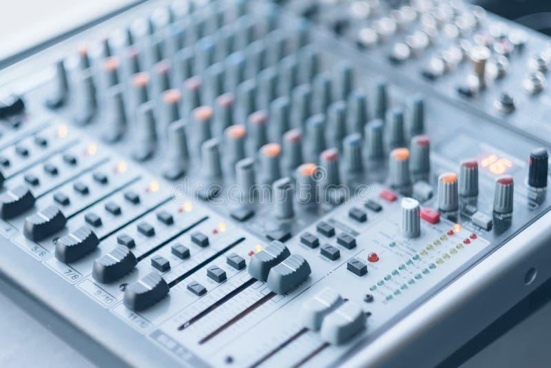 Sound recording studio professional audio mixer. Sound recording studio. Electronic device for combining sounds. Closeup of professional audio mixer royalty free stock photography