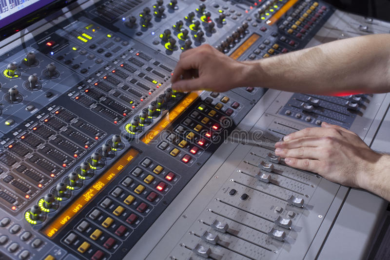 Sound studio adjusting record equipment. Switching and transmission of sound stock images