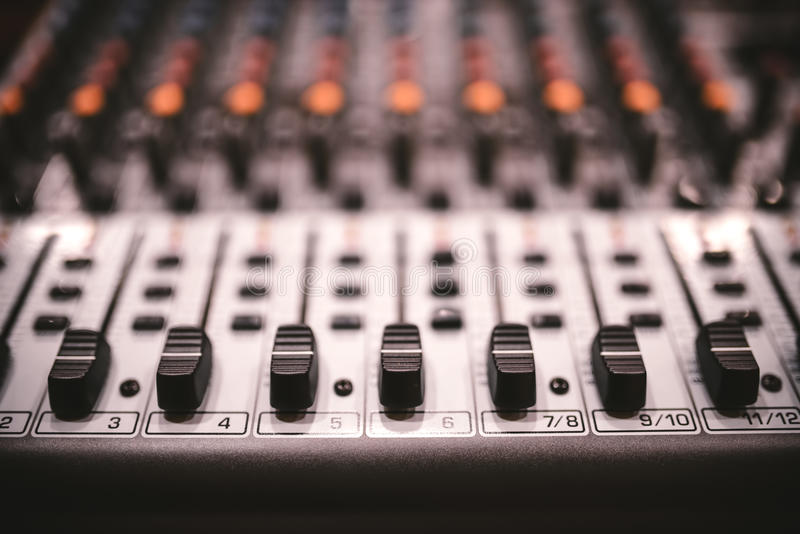 Sound studio recording equipment, music mixer controls at concert or party in a night club. Soft effect on photo royalty free stock image