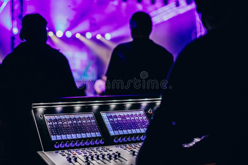 Remote concert sound engineer watching a rock concert stock images