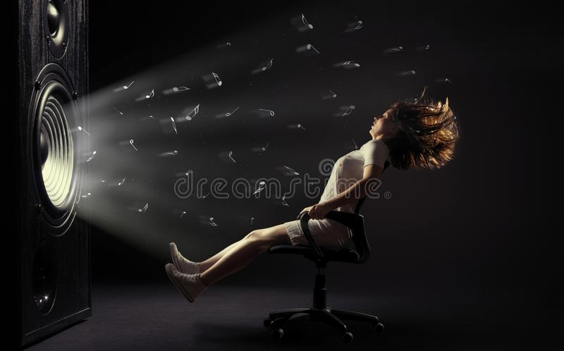 Powerful sound wave. The sound wave set back an office chair with young woman stock photos