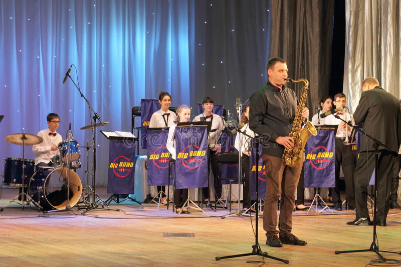 The sounds of music and jazz saxophone. Folk Art Collective Big Band Veto - little band on the stage of the Kyiv Palace of children and youth. Jubilee kontsenrt royalty free stock image