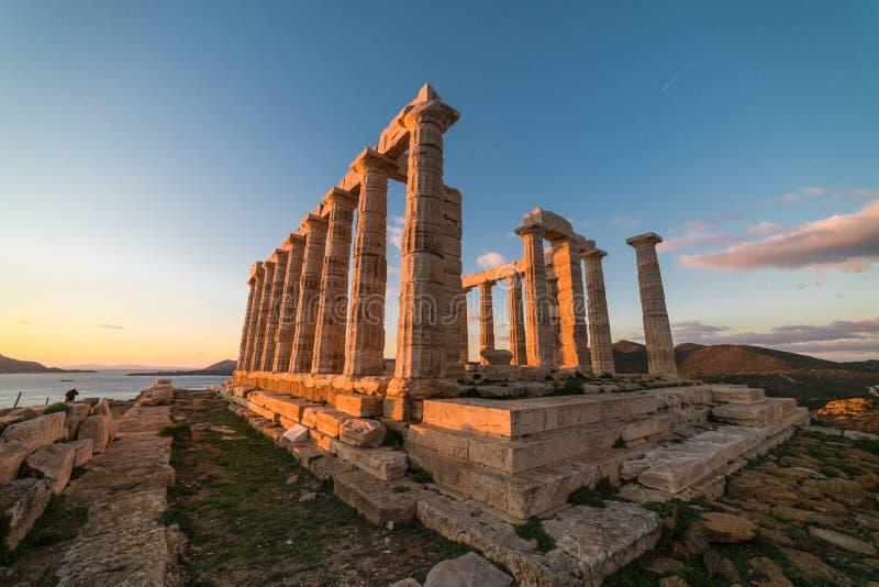 Sounion tempel av Poseidon i Grekland, solnedgångtimme royaltyfri fotografi