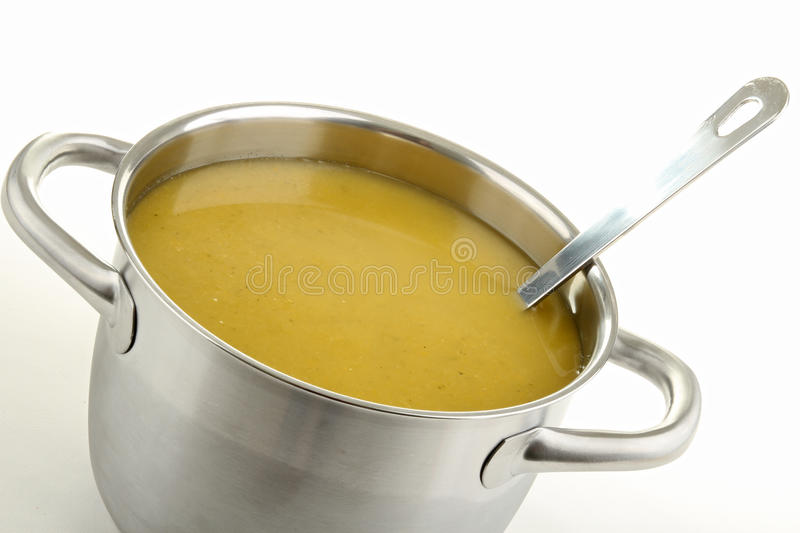 Soup. Cooking pot of soup and ladle stock photography