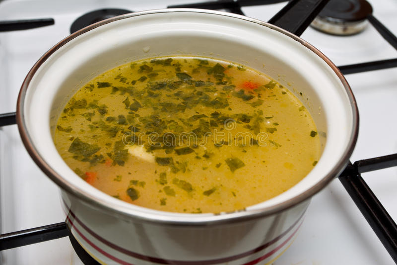 Soup. A heated soup on the stove ready to eat stock photo