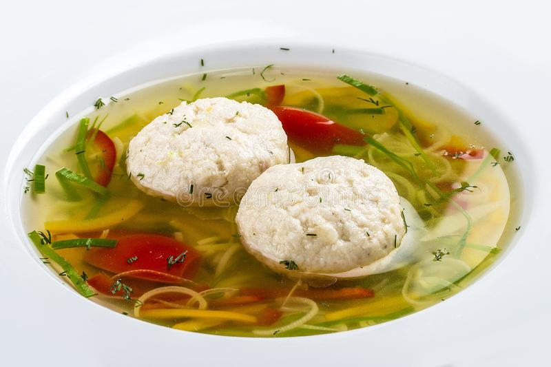 Soup with dumplings from a pike perch stock photography