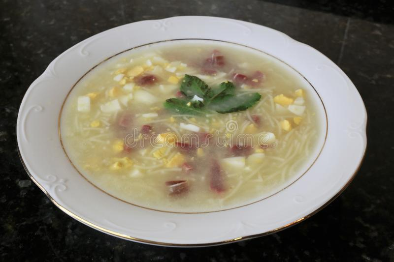 The soup with egg and ham noodles typical Andalusian and Spanish. The soup with egg and ham noodles typical of Andalusian and Spanish cuisine. This is a stock photo
