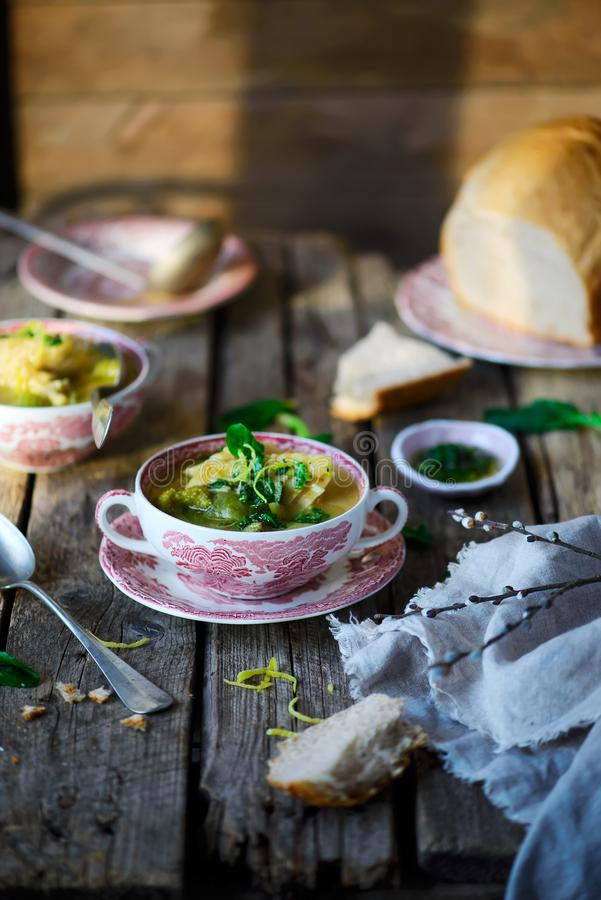 Soup with green vegetables and sea bass. Style rustic.selective focus stock image