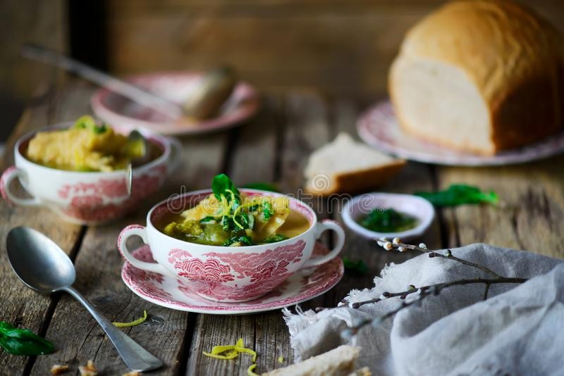 Soup with green vegetables and sea bass. Style rustic.selective focus stock images