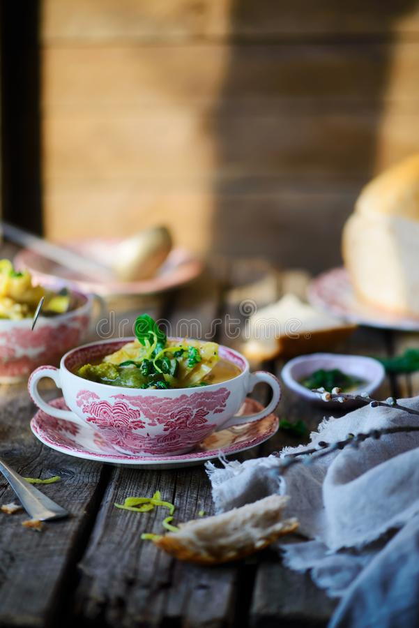 Soup with green vegetables and sea bass. Style rustic.selective focus stock photos