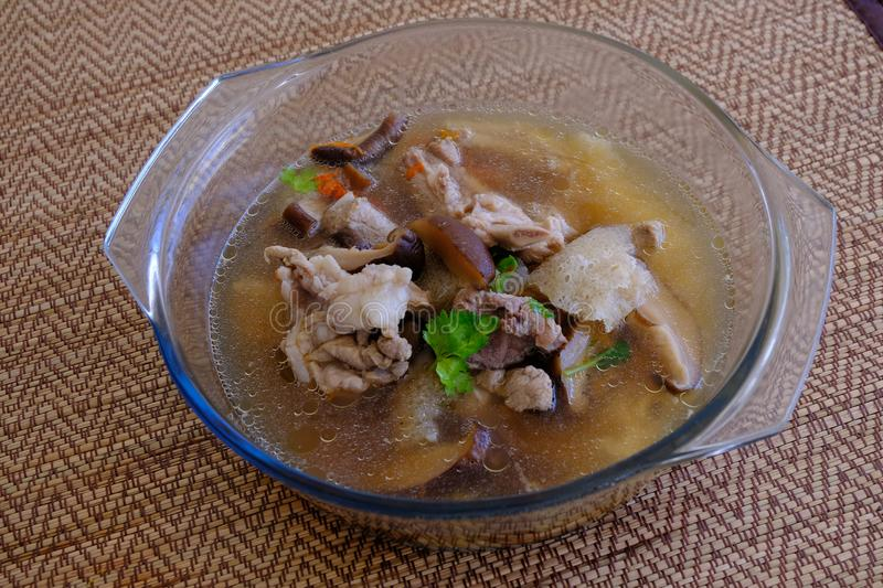 Bamboo Mushroom soup or broth in the Glass bowl royalty free stock photography